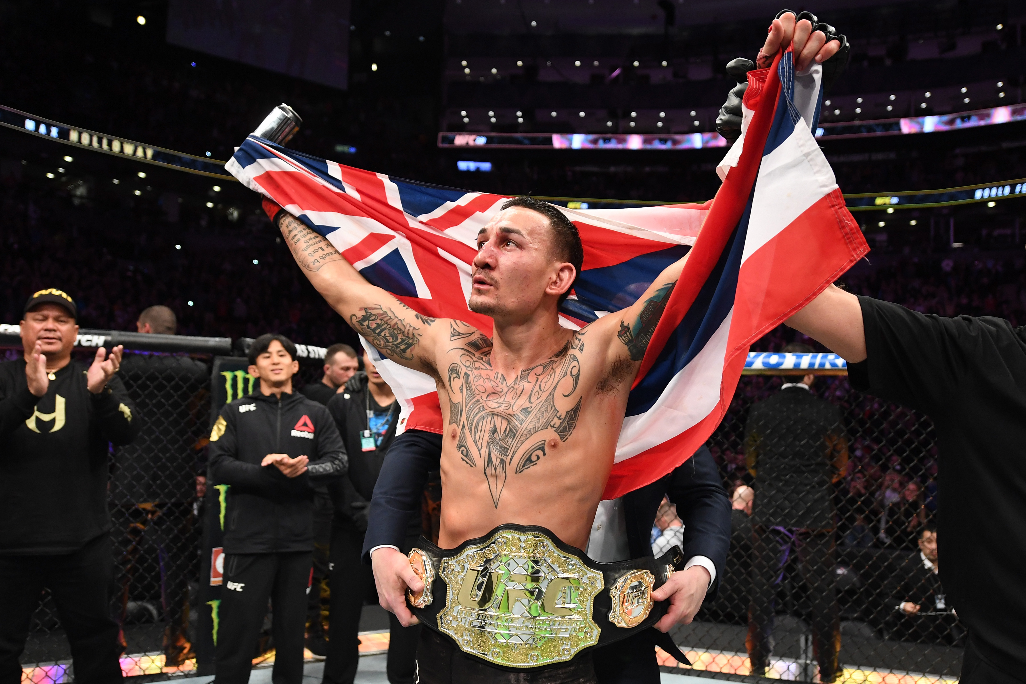TORONTO, CANADA - DECEMBER 08: Max Holloway celebrates his victory over Brian Ortega in their UFC featherweight championship fight during the UFC 231 event at Scotiabank Arena on December 8, 2018 in Toronto, Canada. (Photo by Josh Hedges/Zuffa LLC/Zuffa LLC via Getty Images)