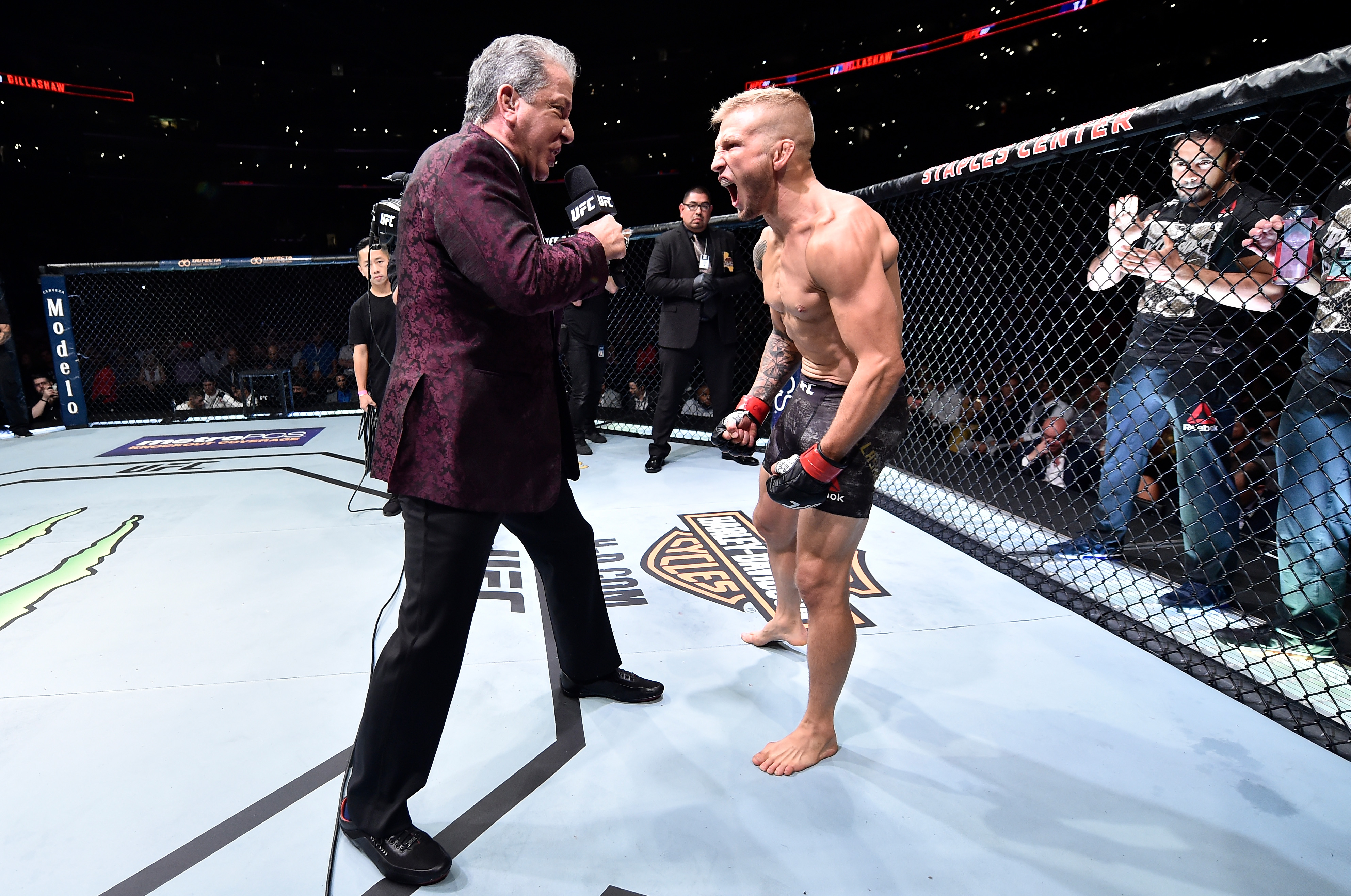 LOS ANGELES, CA - AUGUST 04: <a href='../fighter/TJ-Dillashaw'>TJ Dillashaw</a> is introduced by Bruce Buffer prior to his UFC bantamweight championship fight against <a href='../fighter/cody-garbrandt'>Cody Garbrandt</a> during the UFC 227 event inside Staples Center on August 4, 2018 in Los Angeles, California. (Photo by Jeff Bottari/Zuffa LLC/Zuffa LLC via Getty Images)