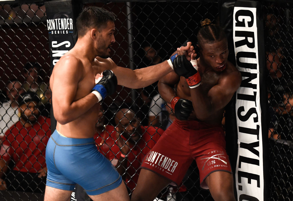 (L-R) Julio Arce punches Peter Petties in their featherweight bout during Dana White's Tuesday Night Contender Series at the TUF Gym on August 8, 2017 in Las Vegas, Nevada. (Photo by Brandon Magnus/DWTNCS)