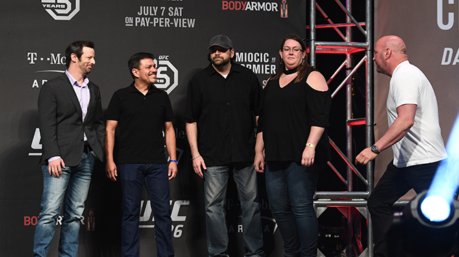 UFC 3 Be the Boss winner John Farmer and his guest Karie Durnell stand on-stage with UFC President Dana White during the UFC 226 weigh-ins at T-Mobile Arena in Las Vegas, NV.