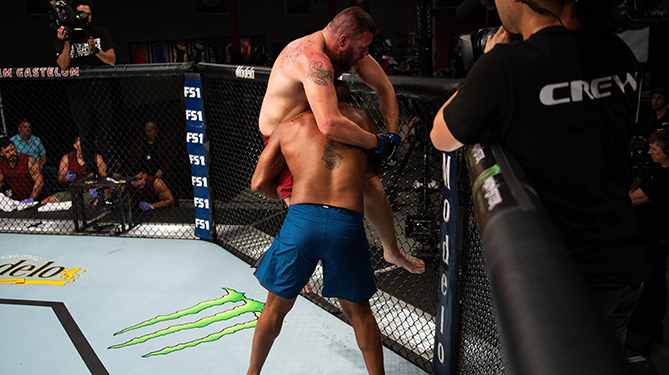 LAS VEGAS, NV - JULY 26: (L-R) Michel Batista takes down Josh Parisian during the filming of The Ultimate Fighter: Heavy Hitters on JULY 26, 2018 in Las Vegas, Nevada. (Photo by Chris Unger/Zuffa LLC via Getty Images)