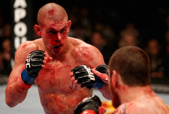 A bloodied Lauzon squares up with Jim Miller