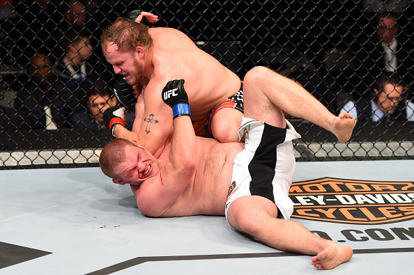 Jared Rosholt (top) lands elbows to the head of Josh Copeland in their heavyweight bout during the UFC 185 event at the American Airlines Center on March 14, 2015 in Dallas, Texas. (Photo by Josh Hedges/Zuffa LLC)