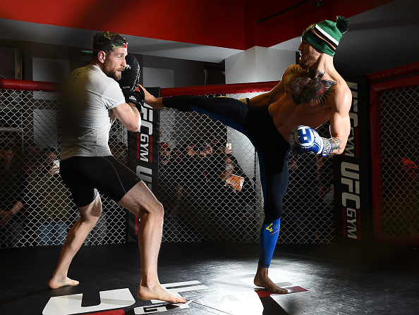 UFC featherweight Conor McGregor of Ireland (R) holds an open training session for the media and fans at UFC Gym on January 15, 2015 in Boston, Massachusetts. (Photo by Jeff Bottari/Zuffa LLC)