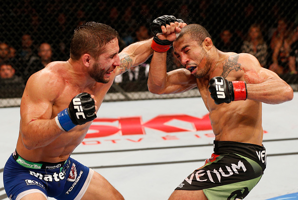 Chad Mendes punches Jose Aldo of Brazil in their featherweight championship bout during the UFC 179 event at Maracanazinho on October 25, 2014 in Rio de Janeiro, Brazil. (Photo by Josh Hedges/Zuffa LLC)