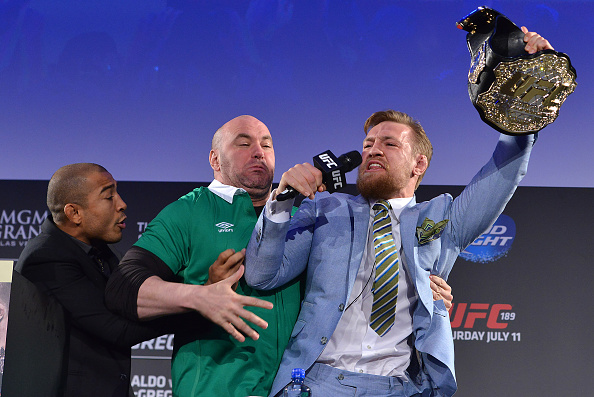 DUBLIN, IRELAND - MARCH 31: Conor McGregor (R) steals Jose Aldo's (L) belt as Dana White (C) separates the two during the UFC 189 World Championship Tour. (Photo by Jeff Bottari/Zuffa LLC/Zuffa LLC)