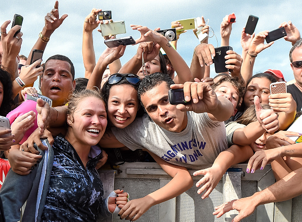 Ronda Rousey takes photos with fans during open training session. (Buda Mendes/Zuffa LLC)
