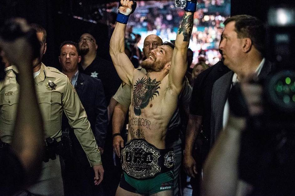 UFC featherweight champion Conor McGregor celebrates after his victory over former longtime champion Jose Aldo at UFC 194 at MGM Grand in Las Vegas.