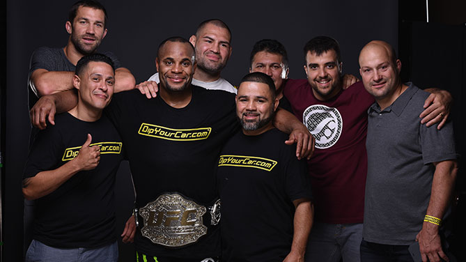 Daniel Cormier and his teammates pose for a post-fight portrait backstage during the UFC 187 event at the MGM Grand Garden Arena on May 23, 2015 in Las Vegas, Nevada. (Photo by Mike Roach/Zuffa LLC/Zuffa LLC via Getty Images)