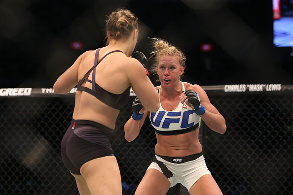 MELBOURNE, AUSTRALIA - NOVEMBER 15:  Ronda Rousey of the United States (L) and Holly Holm of the United States compete in their UFC women's bantamweight championship bout during the UFC 193 event at Etihad Stadium on November 15, 2015 in Melbourne, Austra