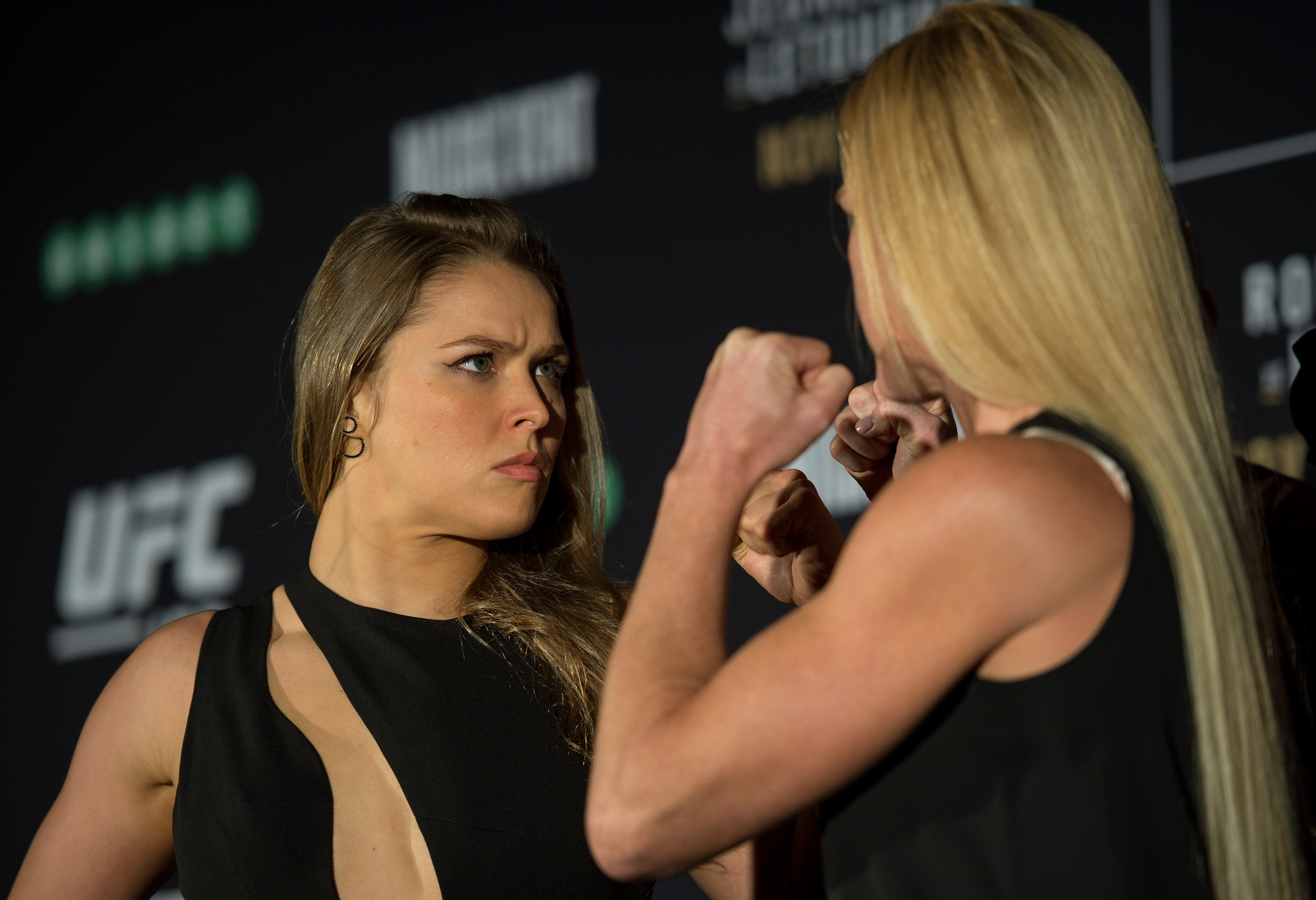 MELBOURNE, AUSTRALIA - NOVEMBER 13:  (L-R) UFC women's bantamweight champion Ronda Rousey of the United States and Holly Holm of the United States face off during the UFC 193 Ultimate Media Day festivities at Etihad Stadium on November 13, 2015 in Melbourne, Australia. (Photo by Brandon Magnus/Zuffa LLC)