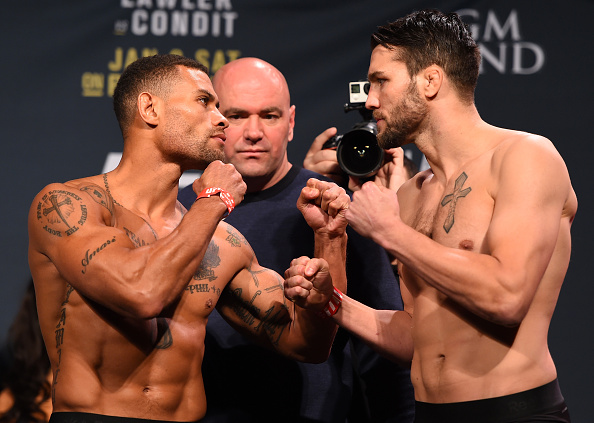 (L-R) Opponents Abel Trujillo and Tony Sims face off during the UFC 195 weigh-in at the MGM Grand Conference Center on January 1, 2016 in Las Vegas, Nevada. (Photo by Josh Hedges/Zuffa LLC)