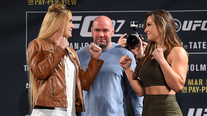UFC President Dana White squares off Holly Holm (L) and Miesha Tate (R) during the UFC 197 on-sale press conference event inside MGM Grand Hotel & Casino on January 20, 2016 in Las Vegas, Nevada. (Photo by Jeff Bottari/Zuffa LLC)