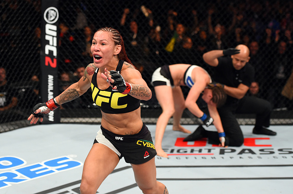 Cris Cyborg celebrates her win over Leslie Smith at UFC 198