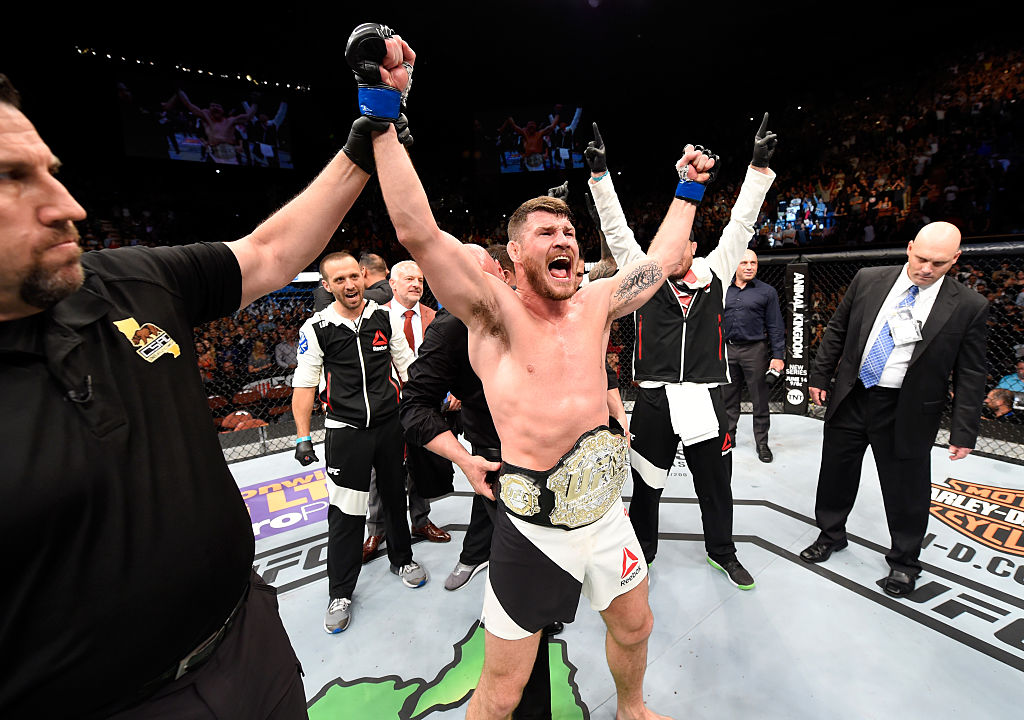 INGLEWOOD, CA - JUNE 04: Michael Bisping of England celebrates after his first round knockout win against Luke Rockhold in their UFC middleweight championship bout during the UFC 199 event at The Forum. (Photo by Josh Hedges/Zuffa LLC)