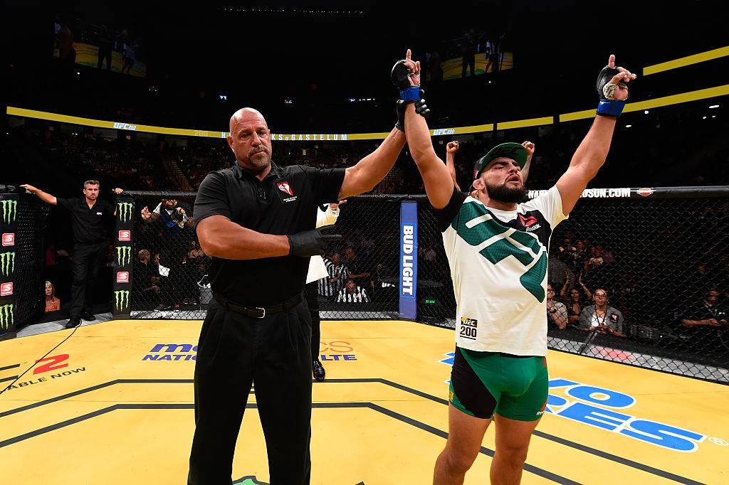 LAS VEGAS, NV - JULY 09: Kelvin Gastelum (right) reacts to his victory over Johny Hendricks in their welterweight bout during the UFC 200 event on July 9, 2016 at T-Mobile Arena in Las Vegas, Nevada. (Photo by Josh Hedges/Zuffa LLC)