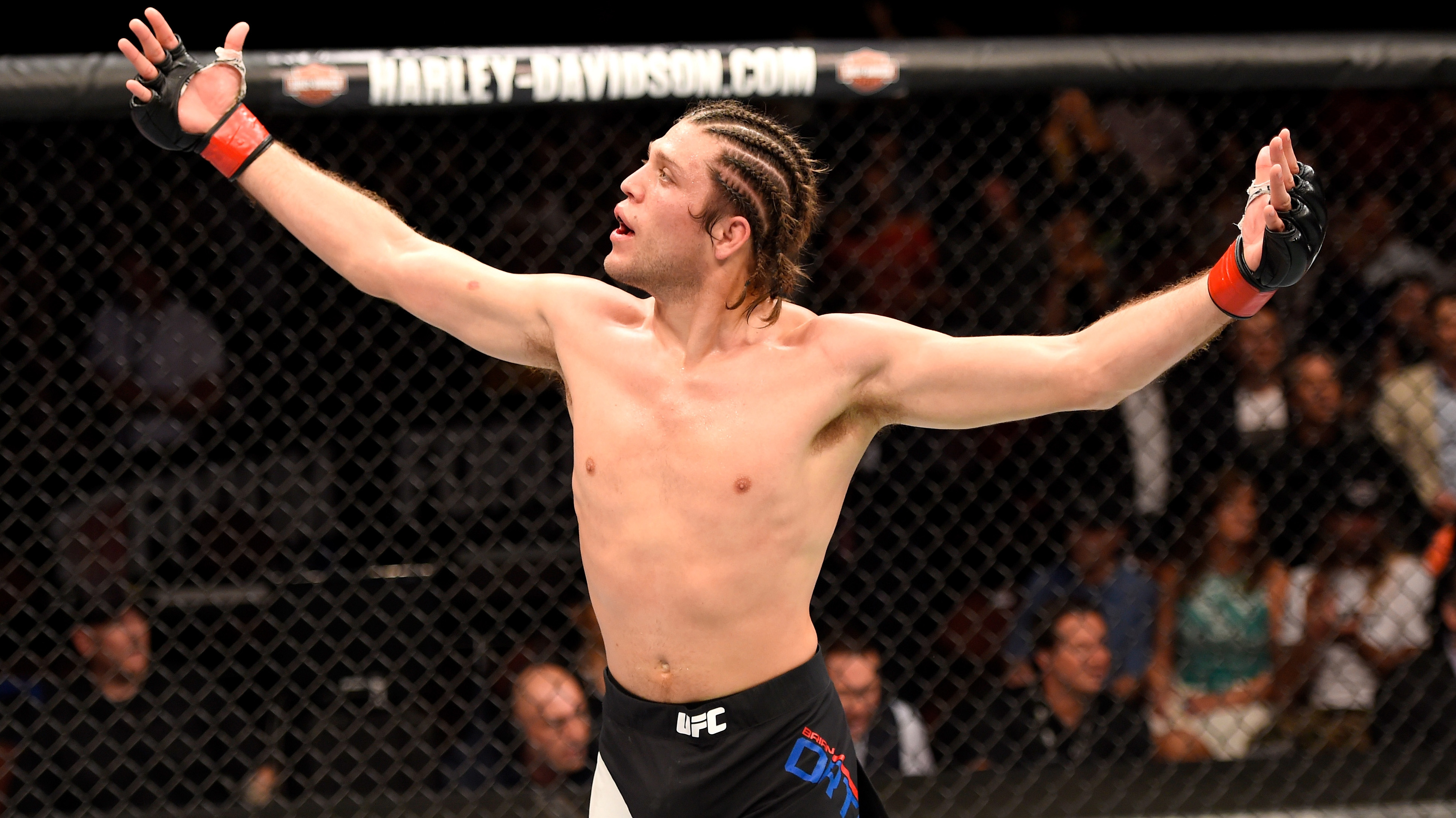 Brian Ortega celebrates after finishing <a href='../fighter/Clay-Guida'>Clay Guida</a> at UFC 199