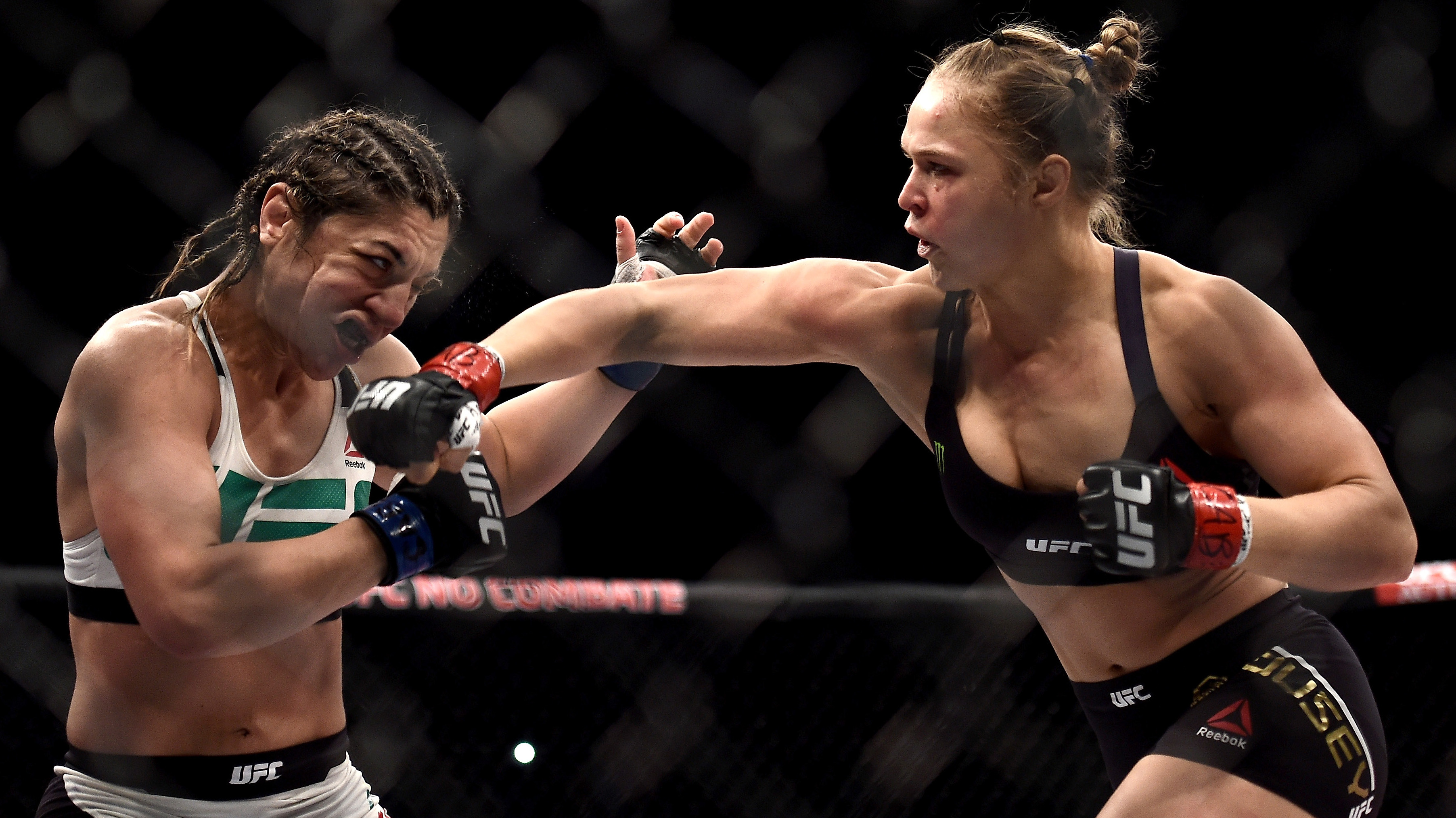 Ronda Rousey of the United States punches Bethe Correia of Brazil in their bantamweight title fight during the UFC 190 Rousey v Correia at HSBC Arena on August 1, 2015 in Rio de Janeiro, Brazil. (Photo by Buda Mendes/Zuffa LLC/Zuffa LLC via Getty Images)