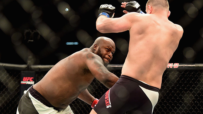 LAS VEGAS, NV - FEB. 06: (L-R) <a href='../fighter/Derrick-Lewis'>Derrick Lewis</a> punches <a href='../fighter/Damian-Grabowski'>Damian Grabowski</a> of Poland in their heavyweight bout during the UFC Fight Night event at MGM Grand Garden Arena. (Photo by Jared C. Tilton /Zuffa LLC)