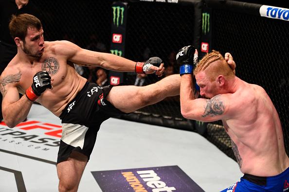 ATLANTA, GA - JULY 30: (L-R) Nikita Krylov kicks Ed Herman in their light heavyweight bout during the UFC 201 event on July 30, 2016 at Philips Arena in Atlanta, Georgia. (Photo by Jeff Bottari/Zuffa LLC)