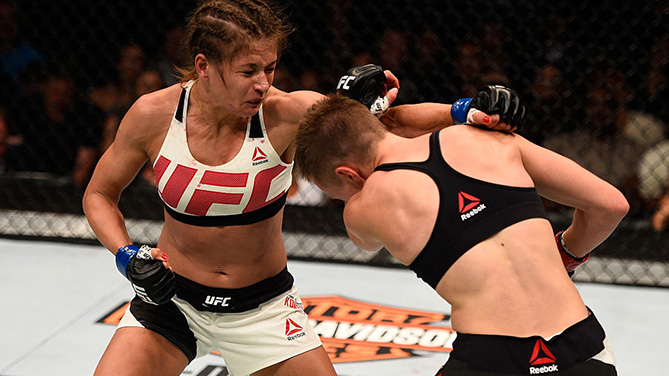 ATLANTA, GA - JULY 30: (L-R) Karolina Kowalkiewicz punches Rose Namajunas in their women's strawweight bout during the UFC 201 event on July 30, 2016. (Photo by Jeff Bottari/Zuffa LLC)