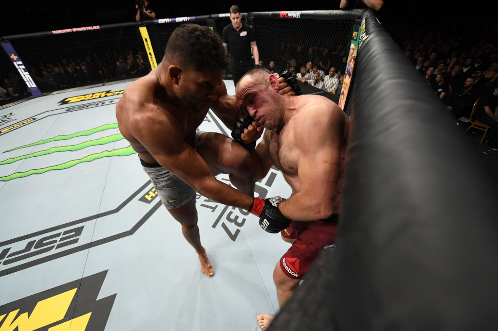 Alistair Overeem of The Netherlands knees Aleksei Oleinik