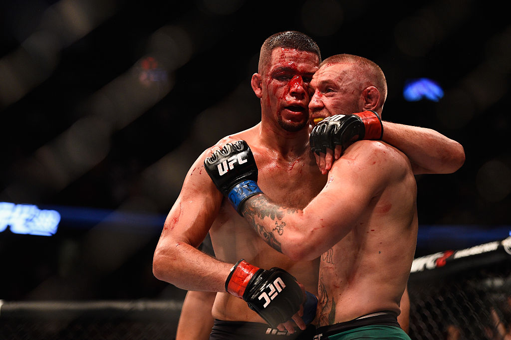 LAS VEGAS, NV - AUG. 20: Nate Diaz shakes hands wih Conor McGregor at the completion of their welterweight bout during the UFC 202 event at T-Mobile Arena. (Photo by Jeff Bottari/Zuffa LLC)