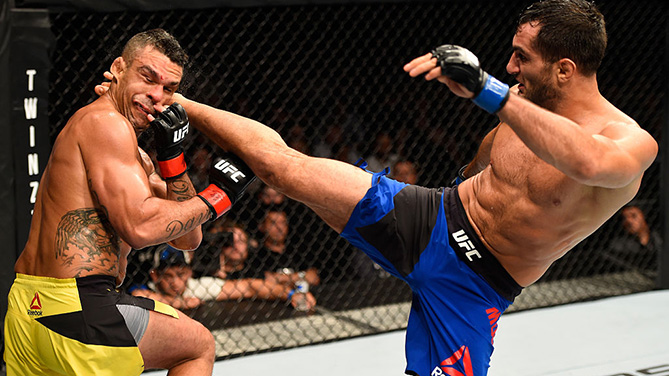 MANCHESTER, ENGLAND - OCTOBER 08: (R-L) Gegard Mousasi of The Netherlands kicks Vitor Belfort of Brazil in their middleweight bout during the UFC 204 Fight Night at the Manchester Evening News Arena. (Photo by Josh Hedges/Zuffa LLC)