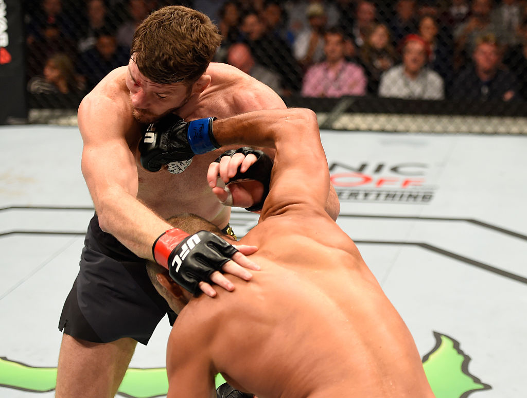 MANCHESTER, ENGLAND - OCTOBER 08: (R-L) Dan Henderson punches Michael Bisping of England in their UFC middleweight championship bout during the UFC 204 Fight Night at the Manchester Evening News Arena on October 8, 2016 in Manchester, England. (Photo by Josh Hedges/Zuffa LLC)