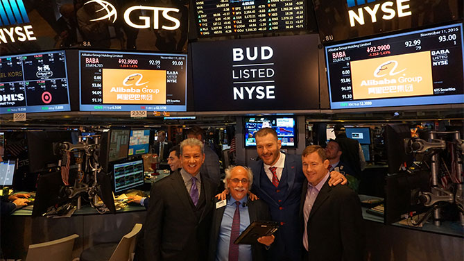 Buffer, Miocic and Hughes with 'the most photographed trader On Wall Street' Peter Tuchman(Photo credit: Nancy Gay/UFC)