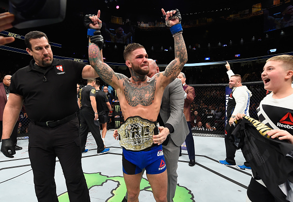 LAS VEGAS, NV - DECEMBER 30: <a href='../fighter/cody-garbrandt'>Cody Garbrandt</a> (center) reacts to his victory over <a href='../fighter/Dominick-Cruz'>Dominick Cruz</a> in their UFC bantamweight championship bout during the UFC 207 event at T-Mobile Arena on December 30, 2016 in Las Vegas, Nevada. (Photo by Josh Hedges/Zuffa LLC)
