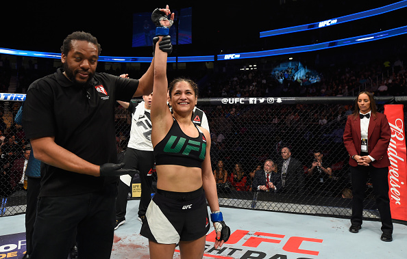 LAS VEGAS, NV - MARCH 04: Cynthia Calvillo reacts to her victory over <a href='../fighter/amanda-cooper'>Amanda Cooper</a> in their women's strawweight bout during the UFC 209 event at T-Mobile Arena on March 4, 2017 in Las Vegas, Nevada. (Photo by Josh Hedges/Zuffa LLC)