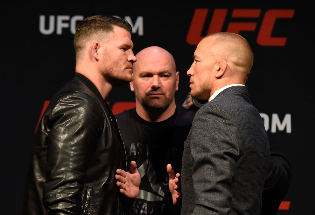 LAS VEGAS, NV - MARCH 03: (L-R) UFC middleweight champion Michael Bisping of England faces off against Georges St-Pierre of Canada during the UFC press conference at T-Mobile arena on March 3, 2017 in Las Vegas, Nevada. (Photo by Josh Hedges/Zuffa LLC)