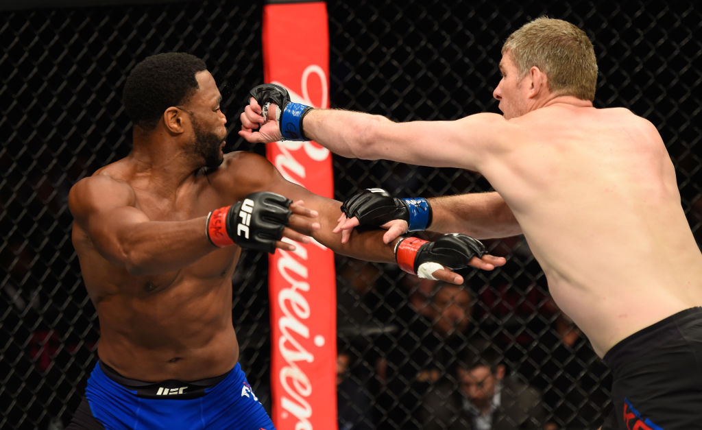 LAS VEGAS, NV - MARCH 04: (R-L) Daniel Kelly of Australia punches Rashad Evans in their middleweight bout during the UFC 209 event at T-Mobile Arena on March 4, 2017 in Las Vegas, Nevada.  (Photo by Josh Hedges/Zuffa LLC)