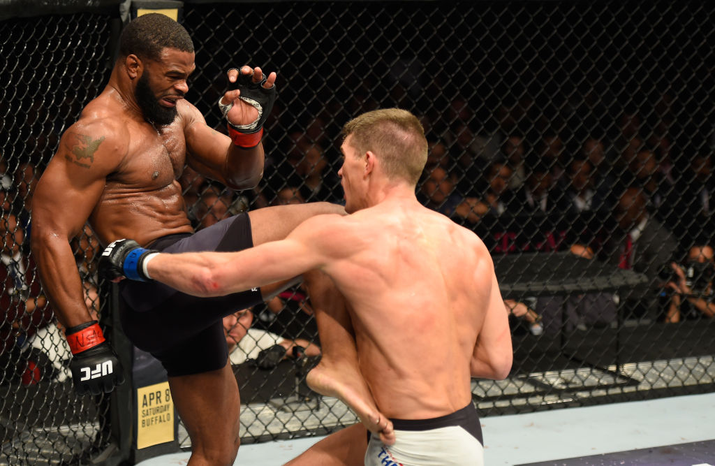 LAS VEGAS, NV - MARCH 04: (L-R) Tyron Woodley knees Stephen Thompson in their UFC welterweight championship bout during the UFC 209 event at T-Mobile Arena on March 4, 2017 in Las Vegas, Nevada. (Photo by Josh Hedges/Zuffa LLC)