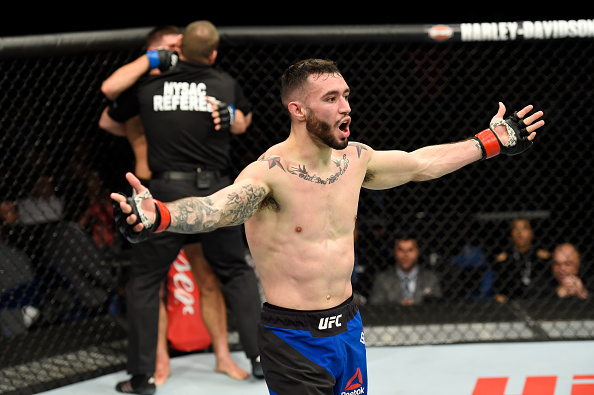 The referee stops the fight as Shane Burgos celebrates his technical knockout victory over <a href='../fighter/charles-rosa'>Charles Rosa</a> in their featherweight bout during the UFC 210 event at KeyBank Center on April 8, 2017 in Buffalo, New York. (Photo by Josh Hedges/Zuffa LLC)