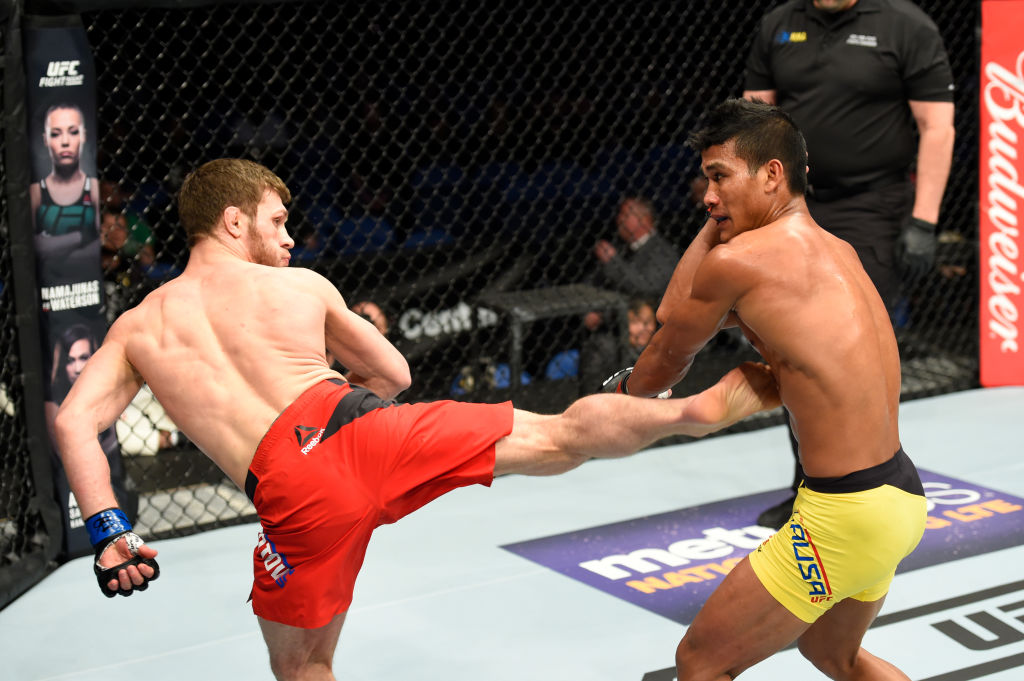 BUFFALO, NY - APRIL 08:  Magomed Bibulatov of Russia (L) lands a kick on Jenel Lausa of the Philippines in their flyweight bout during the UFC 210 event at KeyBank Center on April 8, 2017 in Buffalo, New York.  (Photo by Josh Hedges/Zuffa LLC)