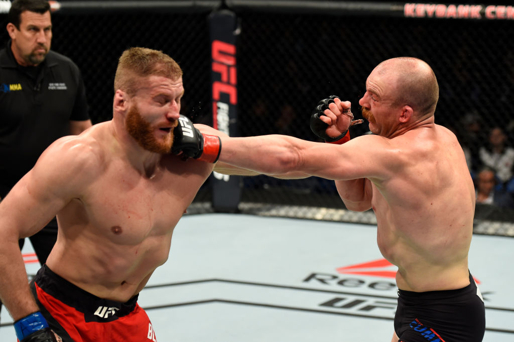 BUFFALO, NY - APRIL 08: Patrick Cummins (R) lands a punch on Jan Blachowicz of Poland in their light heavyweight bout during the UFC 210 event at KeyBank Center on April 8, 2017 in Buffalo, New York.  (Photo by Josh Hedges/Zuffa LLC)