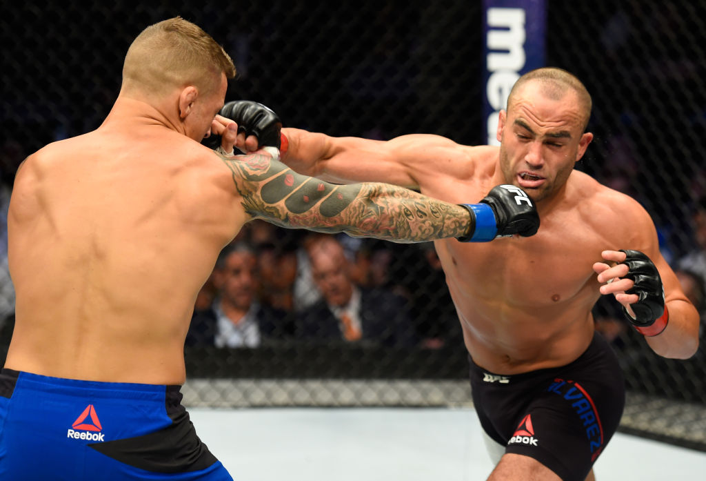 DALLAS, TX - MAY 13:  (L-R) Dustin Poirier punches Eddie Alvarez in their lightweight fight during the UFC 211 event at the American Airlines Center on May 13, 2017 in Dallas, Texas. (Photo by Josh Hedges/Zuffa LLC)