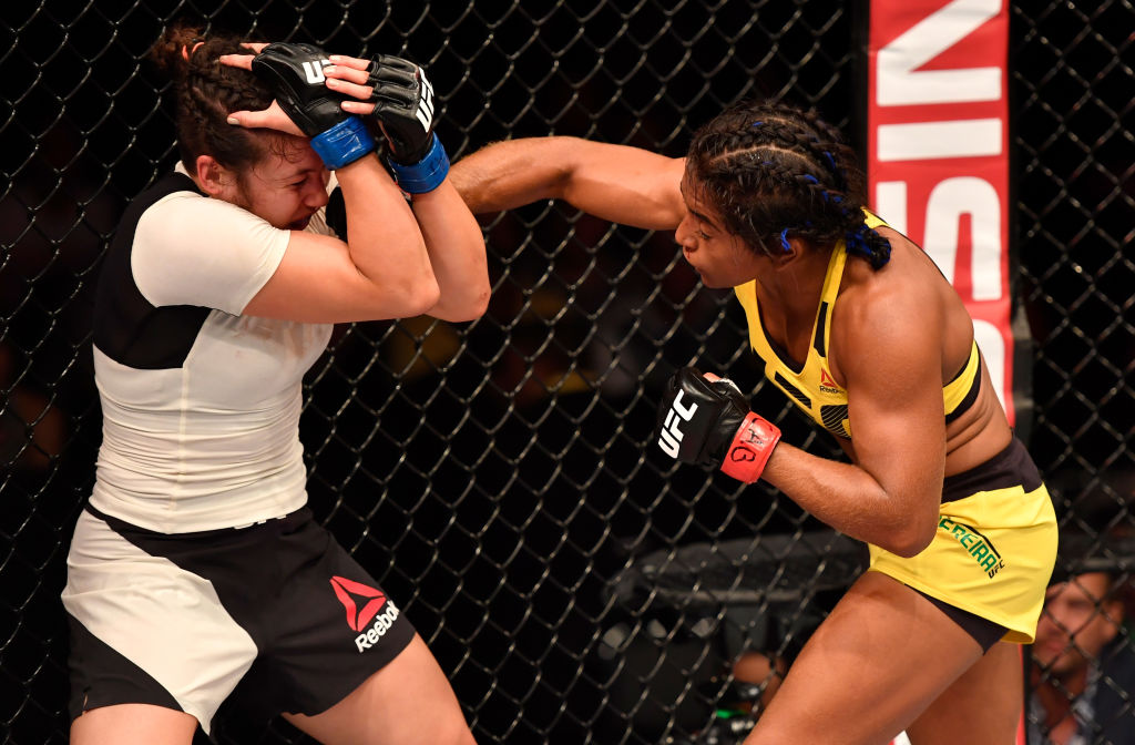 RIO DE JANEIRO, BRAZIL - JUNE 03:  (R-L) Viviane Pereira of Brazil punches Jamie Moyle in their womens strawweight bout during the UFC 212 event at Jeunesse Arena on June 3, 2017 in Rio de Janeiro, Brazil. (Photo by Jeff Bottari/Zuffa LLC)