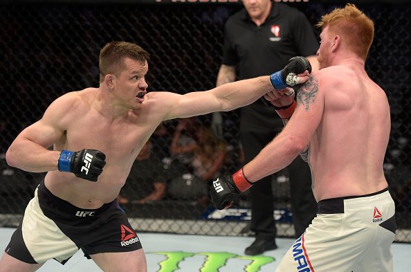 LAS VEGAS, NV - JULY 07: (L-R) CB Dollaway punches Ed Herman in their light heavyweight bout during The Ultimate Fighter Finale at T-Mobile Arena on July 7, 2017 in Las Vegas, Nevada. (Photo by Brandon Magnus/Zuffa LLC/Zuffa LLC via Getty Images)