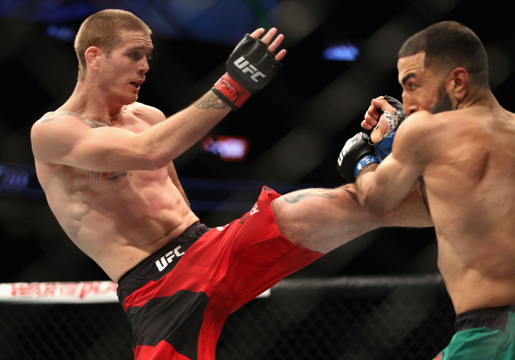 LAS VEGAS, NV - JULY 08:  (L-R) <a href='../fighter/Jordan-Mein'>Jordan Mein</a> kicks <a href='../fighter/Belal-Muhammad'>Belal Muhammad</a> in their welterweight bout during the UFC 213 event at T-Mobile Arena on July 8, 2017 in Las Vegas, Nevada.  (Photo by Christian Petersen/Zuffa LLC)