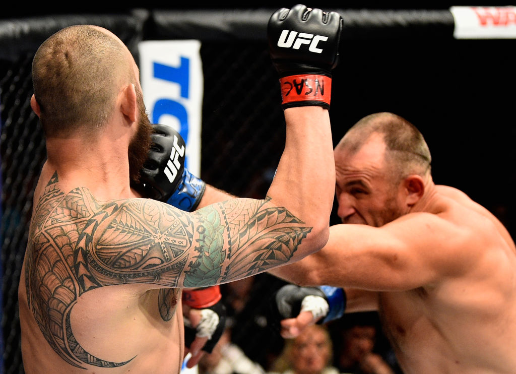 LAS VEGAS, NV - JULY 08: (R-L) <a href='../fighter/Oleksiy-Oliynyk'>Aleksei Oleinik</a> of Russia punches <a href='../fighter/Travis-Browne'>Travis Browne</a> in their heavyweight bout during the UFC 213 event at T-Mobile Arena on July 8, 2017 in Las Vegas, Nevada. (Photo by Jeff Bottari/Zuffa LLC)