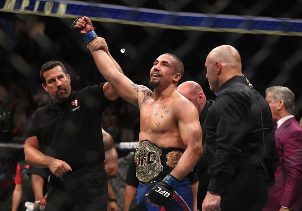 LAS VEGAS, NV - JULY 08:  Robert Whittaker of New Zealand celebrates his victory over Yoel Romero of Cuba in their interim UFC middleweight championship bout during the UFC 213 event at T-Mobile Arena on July 8, 2017 in Las Vegas, Nevada.  (Photo by Christian Petersen/Zuffa LLC)