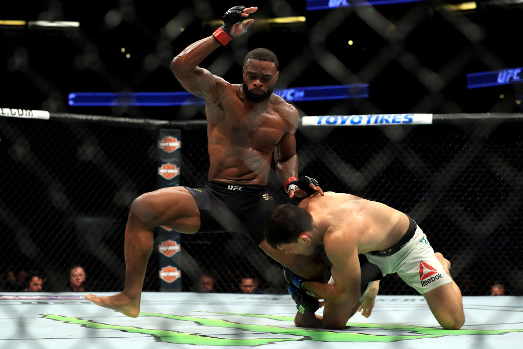 ANAHEIM, CA - JULY 29:  <a href='../fighter/Tyron-Woodley'><a href='../fighter/Tyron-Woodley'>Tyron Woodley</a></a> (black shorts) fights <a href='../fighter/Demian-Maia'><a href='../fighter/Demian-Maia'>Demian Maia</a></a> of Brazil in the Welterweight title bout  during UFC 214 at Honda Center on July 29, 2017 in Anaheim, California.  (Photo by Sean M. Haffey/Getty Images)
