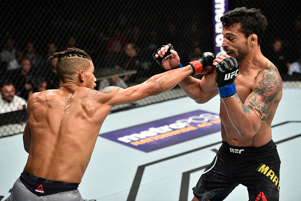 EDMONTON, AB - SEPTEMBER 09:  (L-R) Kajan Johnson of Canada punches Adriano Martins of Brazil in their lightweight bout during the UFC 215 event inside the Rogers Place on September 9, 2017 in Edmonton, Alberta, Canada. (Photo by Jeff Bottari/Zuffa LLC/Zuffa LLC via Getty Images)