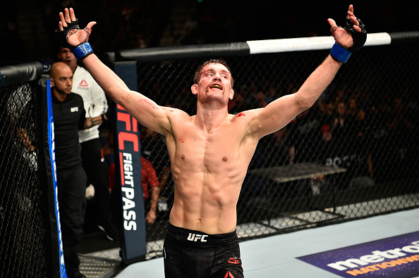 """EDMONTON, AB - SEPTEMBER 09:  Rick Glenn raises his hands after facing Gavin Tucker of Canada in their featherweight bout during the UFC 215 event inside the Rogers Place on September 9, 2017 in Edmonton, Alberta, Canada. (Photo by Jeff Bottari/Zuffa LLC/Zuffa LLC via Getty Images)"""" align="""