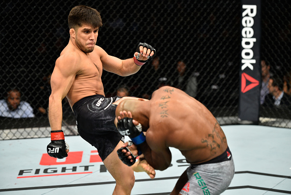 EDMONTON, AB - SEPTEMBER 09:  (L-R) Henry Cejudo kicks Wilson Reis of Brazil in their flyweight bout during the UFC 215 event inside the Rogers Place on September 9, 2017 in Edmonton, Alberta, Canada. (Photo by Jeff Bottari/Zuffa LLC/Zuffa LLC via Getty Images)