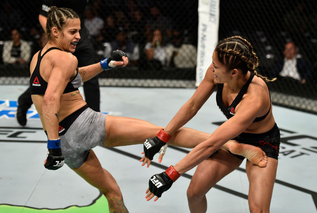 LAS VEGAS, NV - OCTOBER 07: (L-R) Poliana Botelho of Brazil kicks Pearl Gonzalez in their womens strawweight bout during the UFC 216 event inside T-Mobile Arena on October 7, 2017 in Las Vegas, Nevada. (Photo by Jeff Bottari/Zuffa LLC)