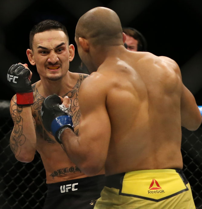 (R) <a href='../fighter/Jose-Aldo'>Jose Aldo</a> punches <a href='../fighter/Max-Holloway'>Max Holloway</a> during UFC 218 on December 2, 2017 in Detroit, Michigan. (Photo by Rey Del Rio/Zuffa LLC)